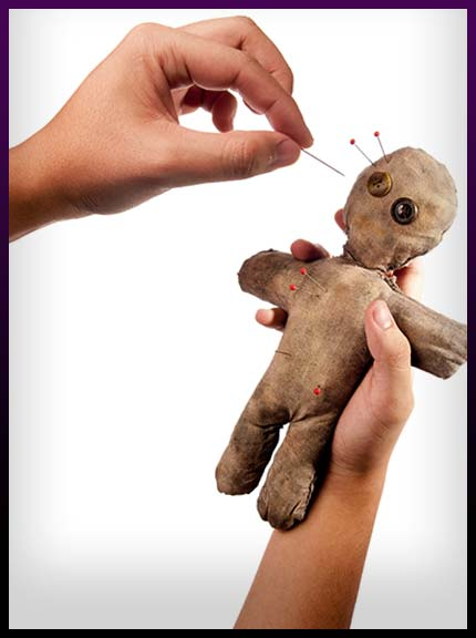 Casting voodoo spell with doll