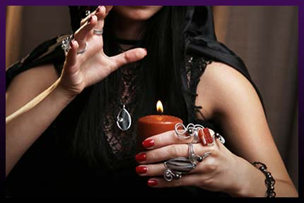 Witch casting love with candle