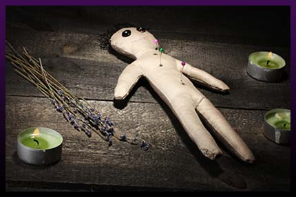 Voodoo doll of black magic spell of love